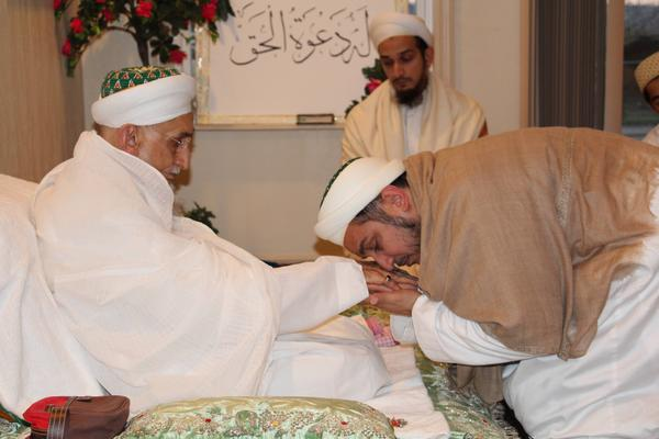 Syedna Fakhruddin performing qadambosi of Syedna Qutbuddin on 27th Muharram 1437H after Urus Majlis - the day the 53rd Dai anointed him as his successor